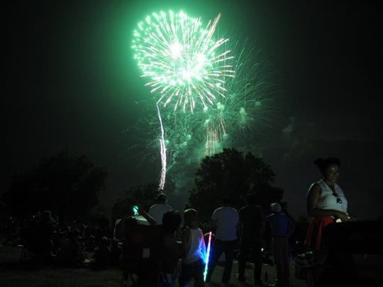Lauren Roberts/Times Record News Thousands of people watch the fireworks at Fourth in the Falls Monday, July 4, 2016, next the Wichita River at the MPEC.
