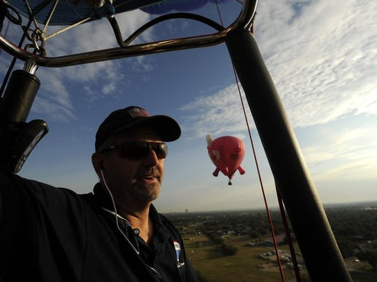 Pilot Bill Broker flies the Re/Max balloon over north Abilene during the 2015 Big Country Balloon Fest.