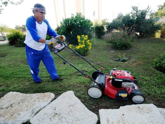 Nellie Doneva/Reporter-News Martin Garcia mows a garden he created and maintains by the recycling center on Buffalo Gap Road. Garcia is the longest-sitting board member of Keep Abilene Beautiful.