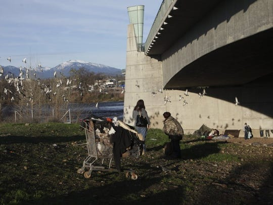 Chris Ormsby of Redding, left, helps conduct the Point in Time Homeless Count on Tuesday, January 26, 2016 around the Cypress Avenue Bridge in Redding. Andreas Fuhrmann/Record Searchlight