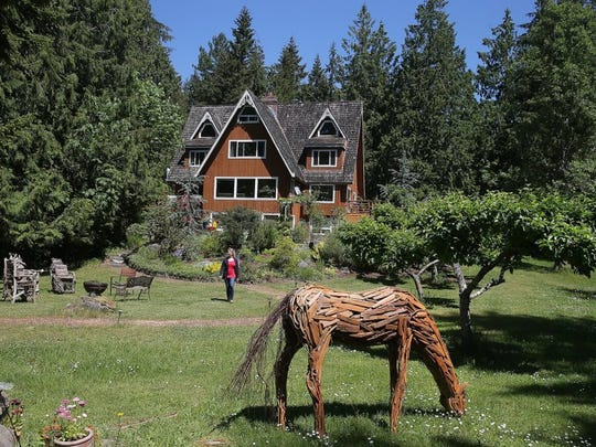Kimberly King walks the grounds at the Green Cat Guest House in Poulsbo. She and her husband, Ken Grantham, are both professional actors in addition to running the bed-and-breakfast.