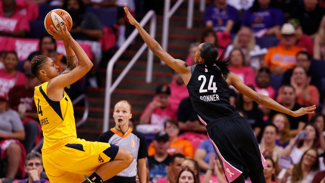 Indiana Fever forward Candice Dupree (4) takes a shot while being guarded by Phoenix Mercury forward DeWanna Bonner (24) during a WNBA game at Talking Stick Resort Arena in Phoenix on August 10, 2018