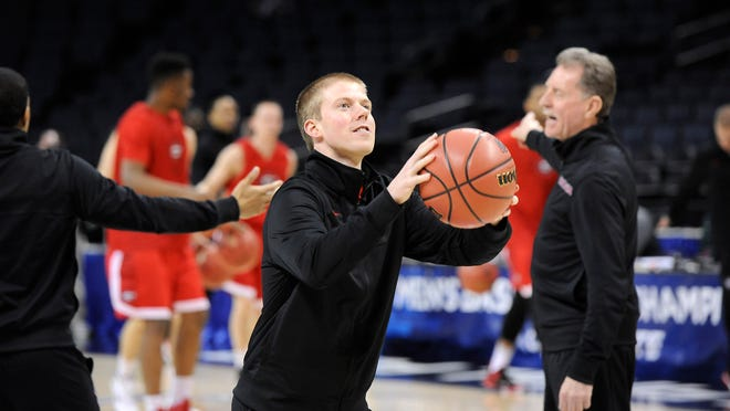 Georgia basketball operations coordinator Matt Bucklin, Tom Izzo's nephew, shoots as he and other assistants have a friendly shoot around as the team gets ready to practice for the NCAA Tournament on Thursday in Charlotte, N.C. Georgia will play MSU on Friday.