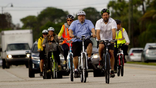 Steve Clark from the League of American Cyclists leads a group of Bonita Springs residents, planners and bicycle advocates including Bonita Springs councilman Mike Gibson, left, on a tour of Bonita Springs in January 2015.