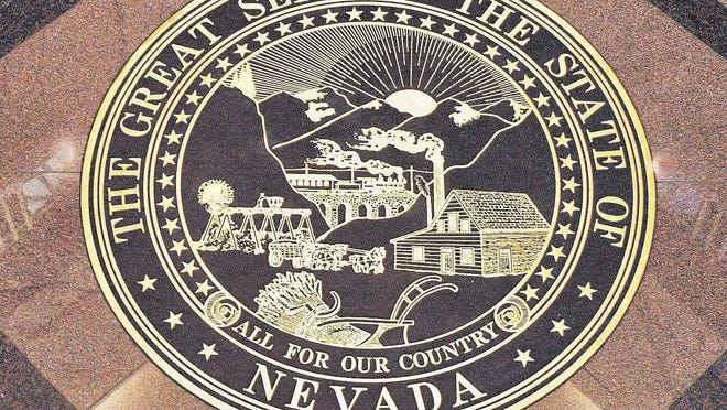 Nevada's seal is displayed on the floor of the Supreme Court of Nevada building.