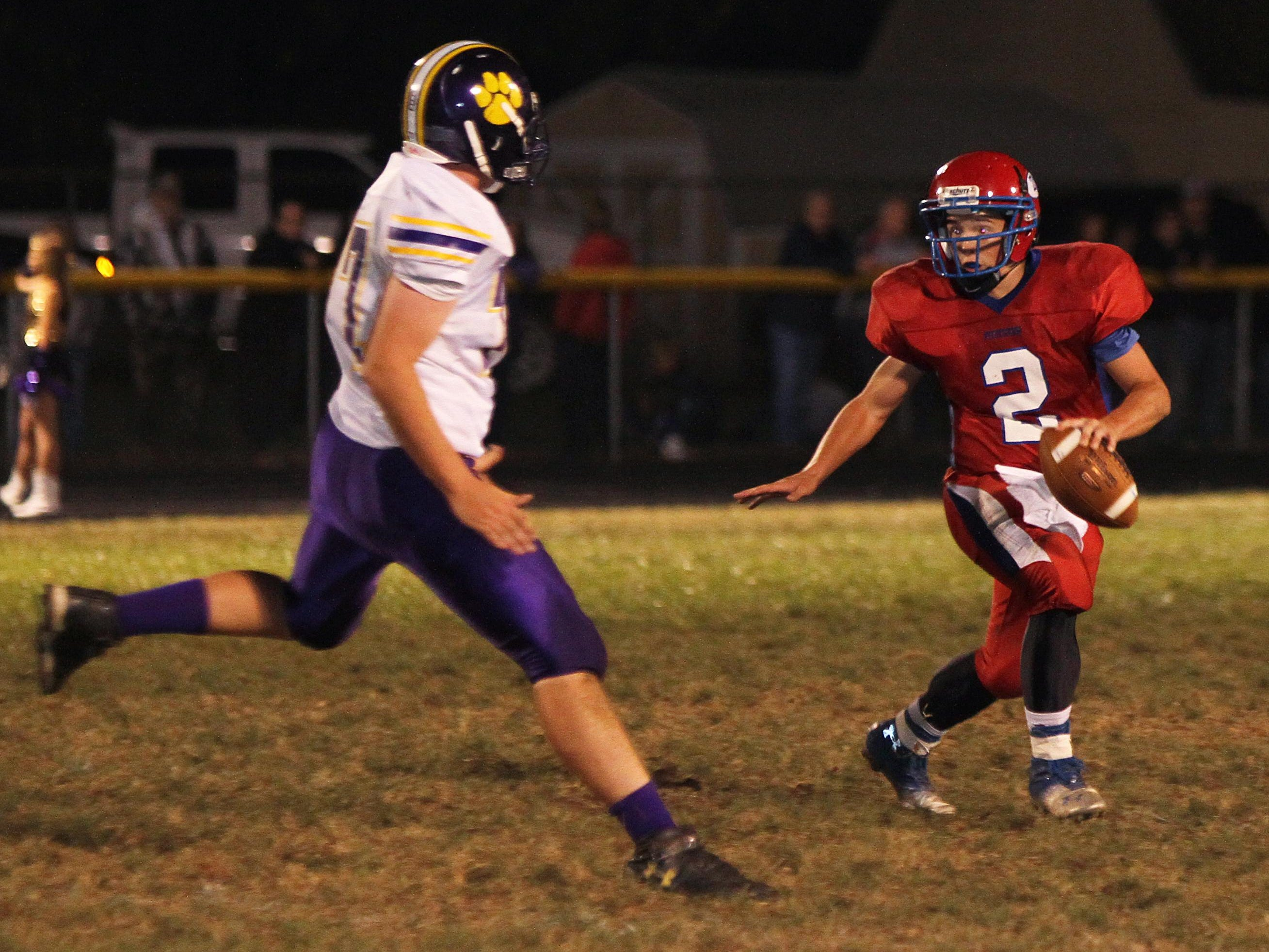 Zane Trace's Joel Dunkle scrambles out of the pocket to avoid a McClain defender during the 2013 season. Dunkle, now a senior, will return to his QB role for the Pioneers this fall.