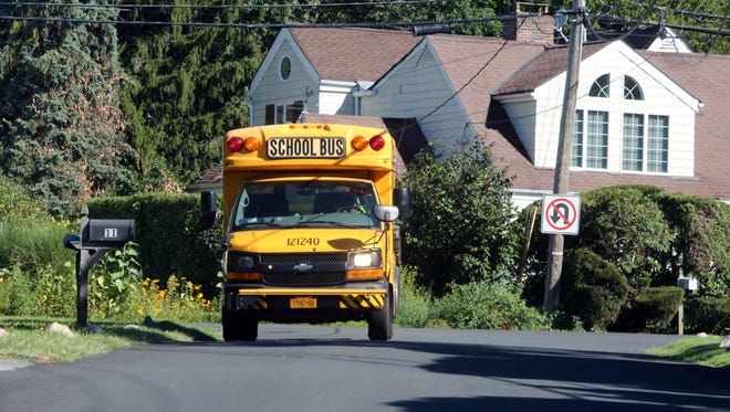 A First Student School Bus travels along Old Well Road in Purchase, Sept. 2, 2016.