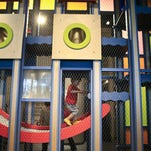 Children play inside the Happy Climber, a 14-foot-tall structure that's part of the new Science in Play at the Kentucky Science Center. The exhibit features 14 learning stations that challenge kids' creative senses. July 2, 2015