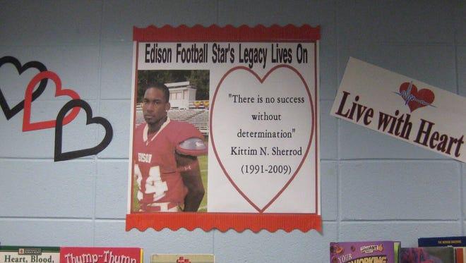 Display at Edison Main Public Library in honor of former Edison High School football star Kittim Sherrod