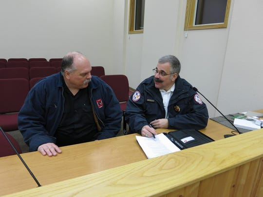 Then-Rib Mountain Fire Chief Paul Wirth, left, discusses the South Area Fire and Emergency Response District with then-Weston Fire Chief Steve Meilahn in this 2013 photo.