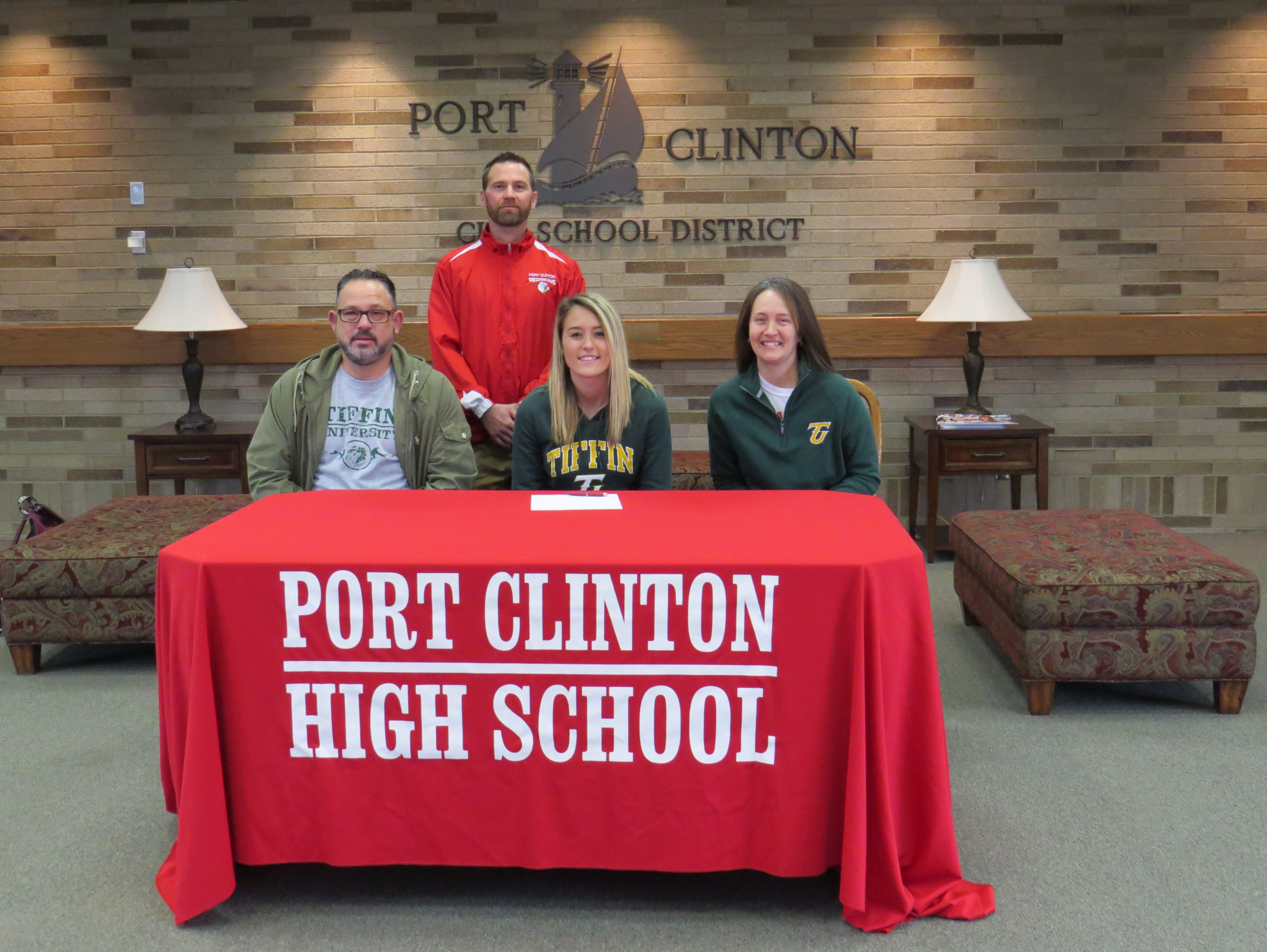 Port Clinton senior Ashtyn Baney, center, will continue her track career at Tiffin University. Baney is joined by her father, Jeff, and mother, Nikki. Redskins track coach Seth Benner is standing.