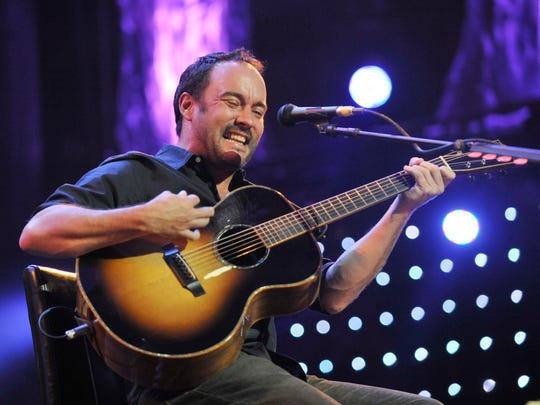 Dave Matthews performs during the Farm Aid 2013 concert at Saratoga Performing Arts Center in Saratoga Springs, N.Y., Saturday, Sept. 21, 2013. (AP Photo/Hans Pennink)