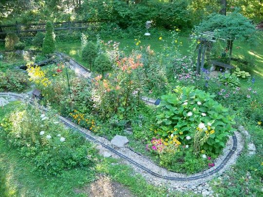 Thomas Murphy's backyard garden railway is shown in the summer of 2015.