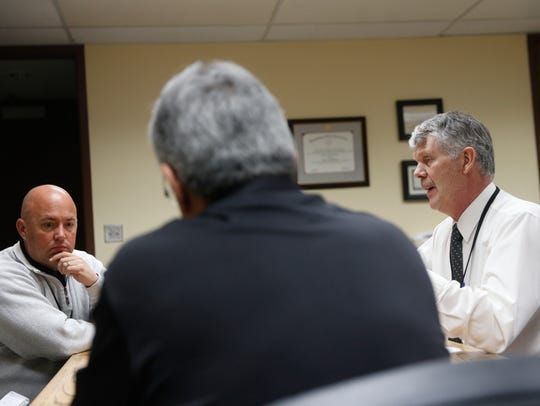From left, Farmington Municipal Schools Director of Support Services Cody Diehl, Deputy Superintendent Phil Valdez and Superintendent Eugene Schmidt talk school safety on Friday during a meeting at the Farmington Municipal School District office.