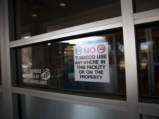 A no smoking sign is posted on the door of the San Juan Regional Medical Center emergency room in Farmington. The hospital is offering a smoking cessation program in April and May.
