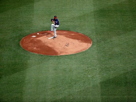 Minnesota Twins starting pitcher Jake Odorizzi throws