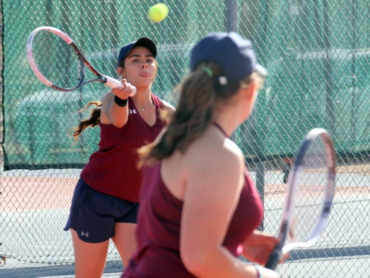 Katelyn Seats, left, led a clean sweep of three Deming doubles matches during Tuesday's 7-2 District 3-5A dual victory over Santa Teresa High School.