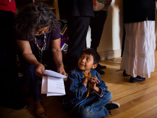 Katherine Sells, left, and her grandson Jacob Sells attend a mass on Wednesday at the Episcopal Church in Navajoland in Farmington.