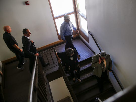 Aztec Municipal School District Superintendent Kirk Carpenter, below right, walks with members of the Legislative Education Study Committee Tuesda during a tour of Aztec High School.