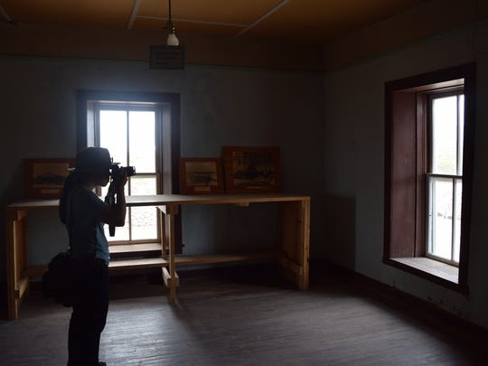 Sim Chi Yin takes photos inside the McDonald Ranch House where the plutonium bomb was assembled.