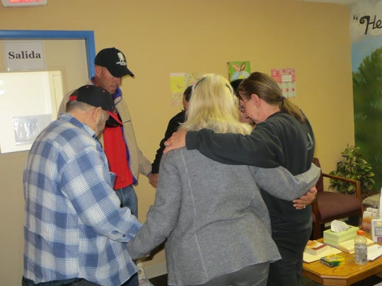 Prayer partners and patients pray at the Compassion Community Clinic free faith-based dental clinic in Sparks