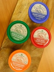 Pine River's gourmet cheese spread flavors Friday, Nov. 17, 2017, in Newton, Wisconsin
