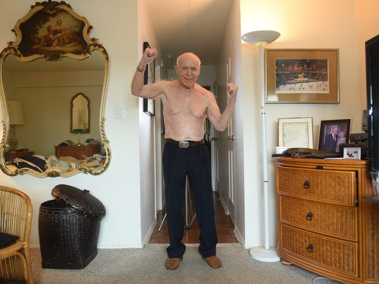 Sidney Gottlieb (age 92) of Cliffside Park, who has set a record in the Senior Olympics, shows off his upper body as he exercises at his home in Cliffside Park on 06/13/18. Sidney runs, does 100 situps every day, pushups,etc lifts weights. He considers himself a role model for other seniors to stay active.
