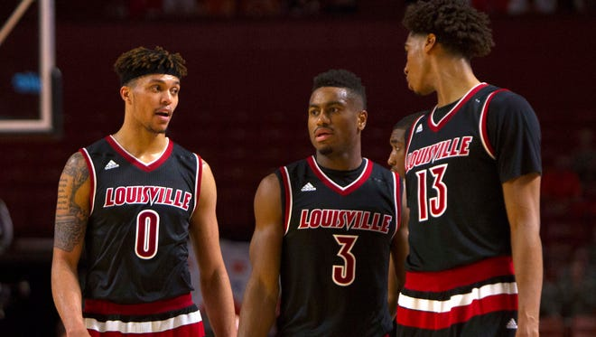 Louisville Cardinals guards Damion Lee (0) and Trey Lewis (3).