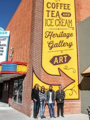 From left to right, artists Justin and Angie Nowell, Alamogordo MainStreet Executive Director Cam Wilde and Executive Director of the Flickinger Center for Performing Arts Jim Mack stand in front of the finished mural on the south side of the Flickinger Center for Performing Arts Monday.