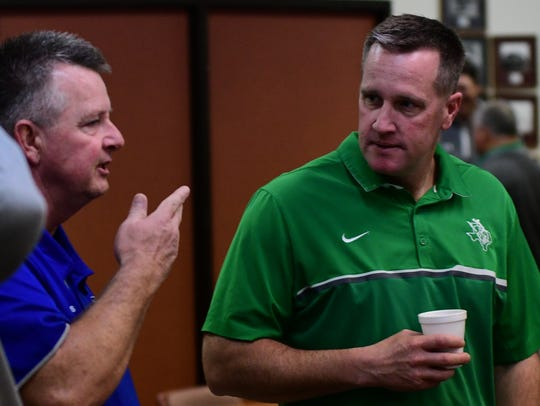 Stamford's Ronnie Casey (left) visits with Breckenridge's