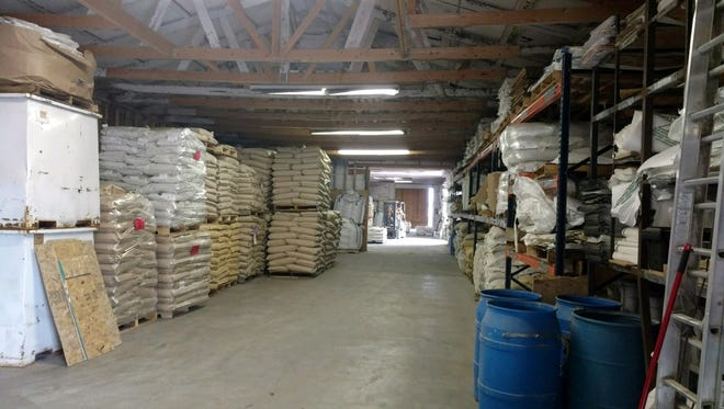 Bags of grain seeds are packed nearly to the ceiling. This time of year warehouse space at dealerships can become a daily challenge,.