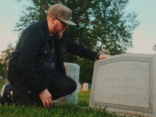 Jason Jones visits the grave of his late grandmother,