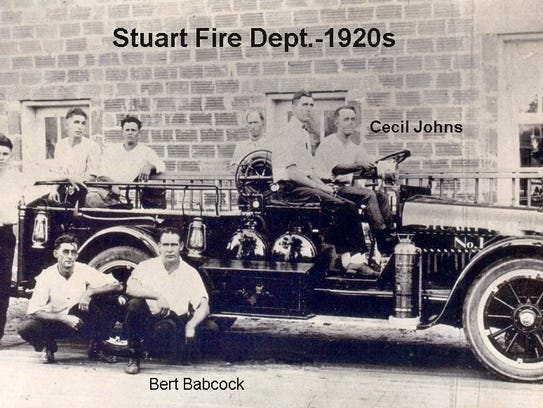 The fire truck built by Babcock and the firemen on