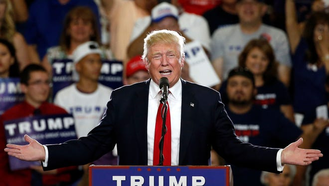 In this May 24, 2016 file photo, Republican presidential candidate Donald Trump speaks at a campaign event in Albuquerque, N.M. According to an AP count: Trump has reached the number of delegates needed to clinch the Republican nomination for president. Trump, the only remaining GOP candidate left in the race, will go on to accept the nomination at the party's national convention in Cleveland.
