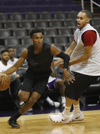 Gino Littles dribbles against other tryout attendees during G-League tryouts at Talking Stick Resort Arena in Phoenix on Sept. 15, 2018.
