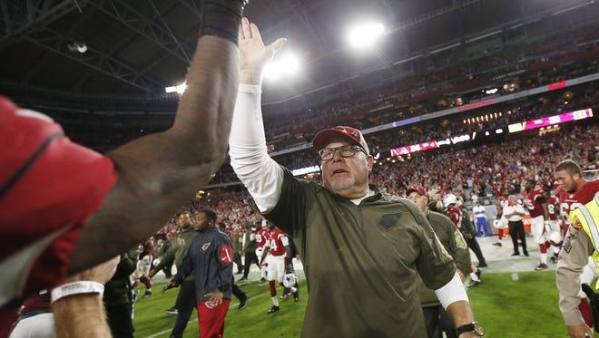 Arizona Cardinals head coach Bruce Arians celebrates his team's 34-31 victory against the Cincinnati Bengals during NFL action November 22, 2015 in Glendale, Ariz.