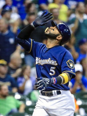 Jonathan Villar reacts as he scores after hitting his second solo home run of the night in the eighth inning of Wednesday's win over the Cubs.