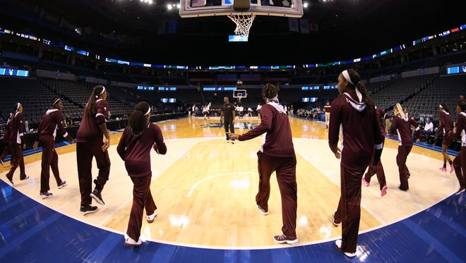 Mississippi State's women's basketball team goes through drills in the NCAA Tournament while led by strength and conditioning coach Anthony Harvey.