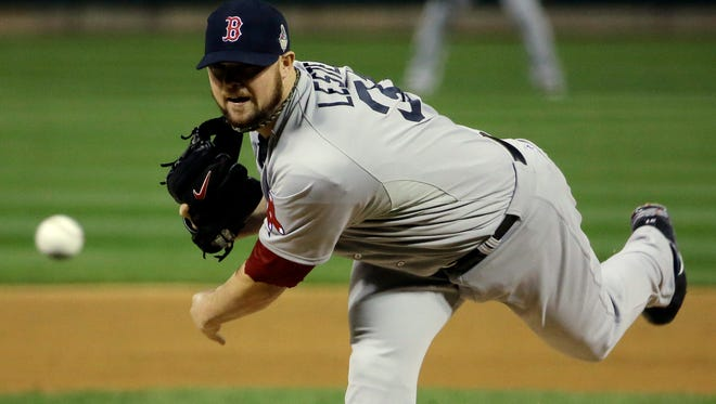 Boston Red Sox starting pitcher Jon Lester throws a pitch against the St. Louis Cardinals in the first inning during Game 5 of the MLB baseball World Series at Busch Stadium.
