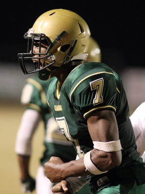 Acadiana's Kevin Moore celebrates after scoring a touchdown against Zachary in a high school 5A semi-final playoff football game Friday, December 5, 2014, at Acadiana High in Scott, La. Acadiana won 9-3.