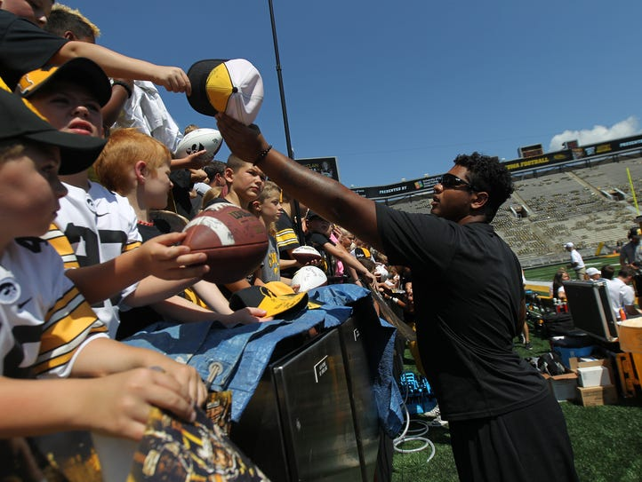 Iowa's Tristan Wirfs signs autographs during the open