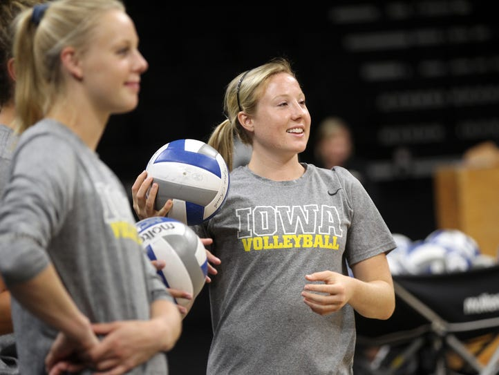 Iowa's Annika Olsen warms up during practice at Carver-Hawkeye