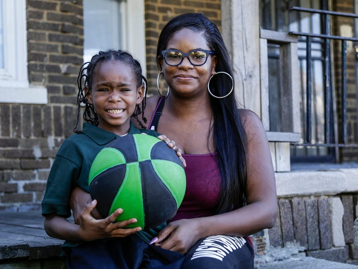 Denise Tanks and her son Amar Tanks, 6, pose for a