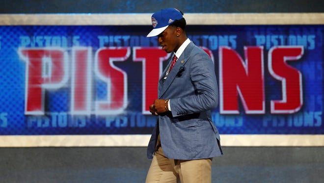 Stanley Johnson celebrates after being selected eighth overall by the Detroit Pistons in the  NBA draft.