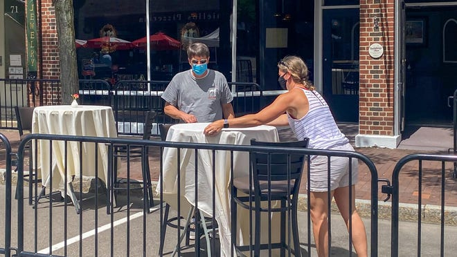 John and Debra Loehnert, owners of Three Birds, set up the outdoor seating section in front of their Market Street business. The large restaurant provides seating in first- and second-floor sections and in the outdoor space. Three Birds will be open Tuesday through Saturday.