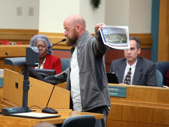 Joe Hilliard holds up a rendering of what Shoreline