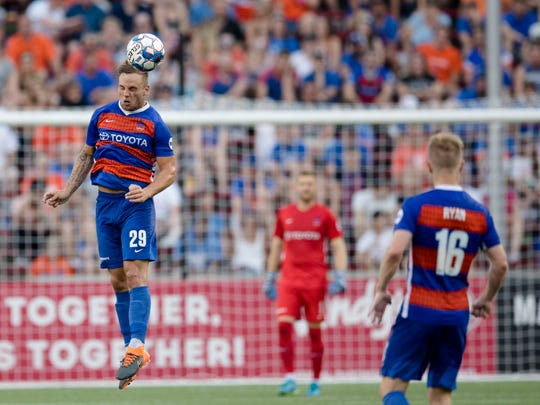 FC Cincinnati defender Paddy Barrett (29) heads the