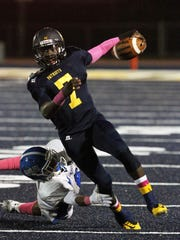 Colonia High School senior quarterback Tenny Adewusi, seen here in an Oct. 3 game against Carteret, is the Home News Tribune 2014 All-Area Football Offensive Player of the Year.