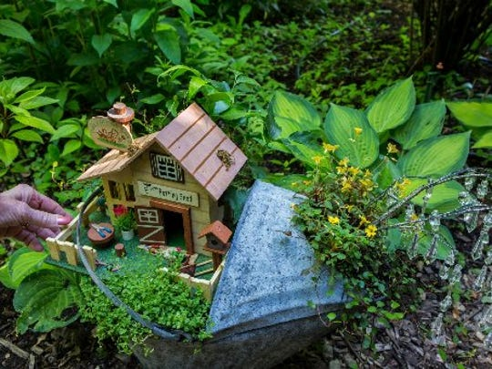 The Potting Shed, one of Nancy Eleder's tiny fairy gardens, shows how plants are chosen to grow in scale with the small figurines.