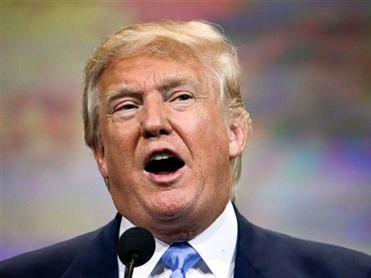 In this April 10, 2015, photo, Donald Trump speaks at the National Rifle Association convention in Nashville, Tenn.